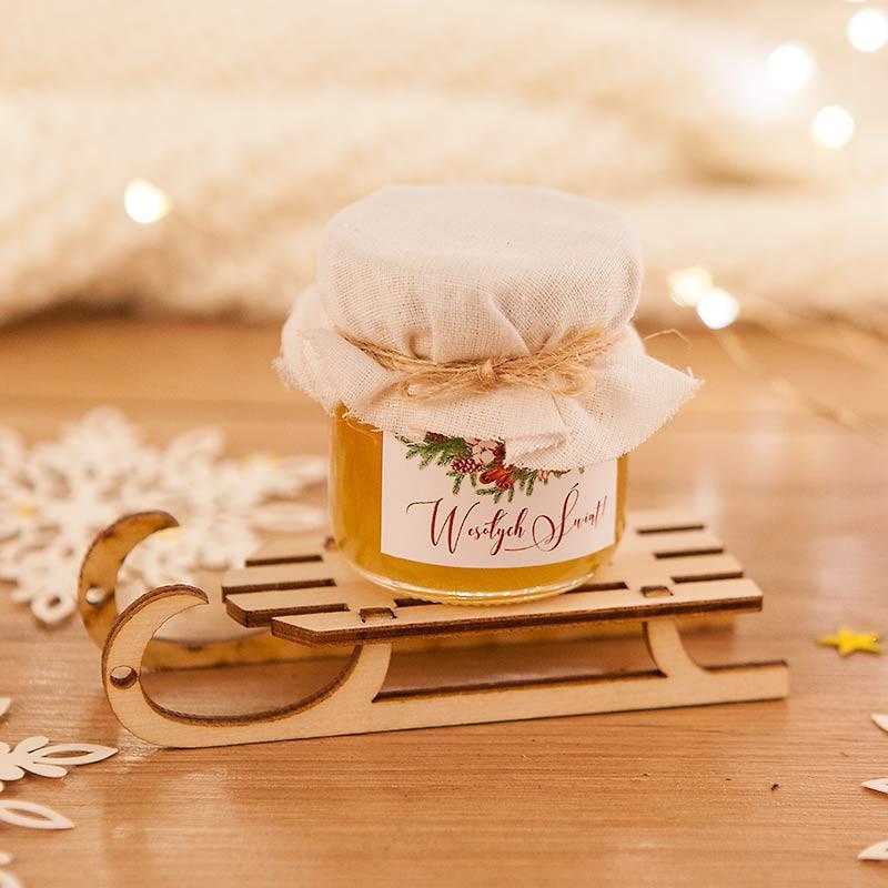 Drobny prezent świąteczny w postaci miodu na saneczkach